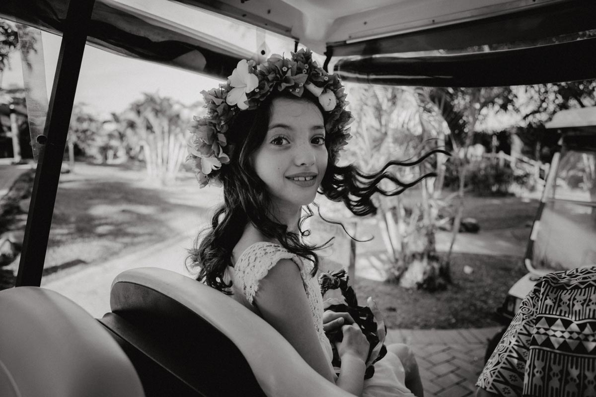 Outrigger weddings photos Fiji Beach Resort flowergirl golfcart