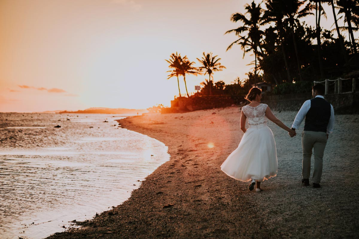 Outrigger Fiji Beach Resort weddings photos golden light sunset beach