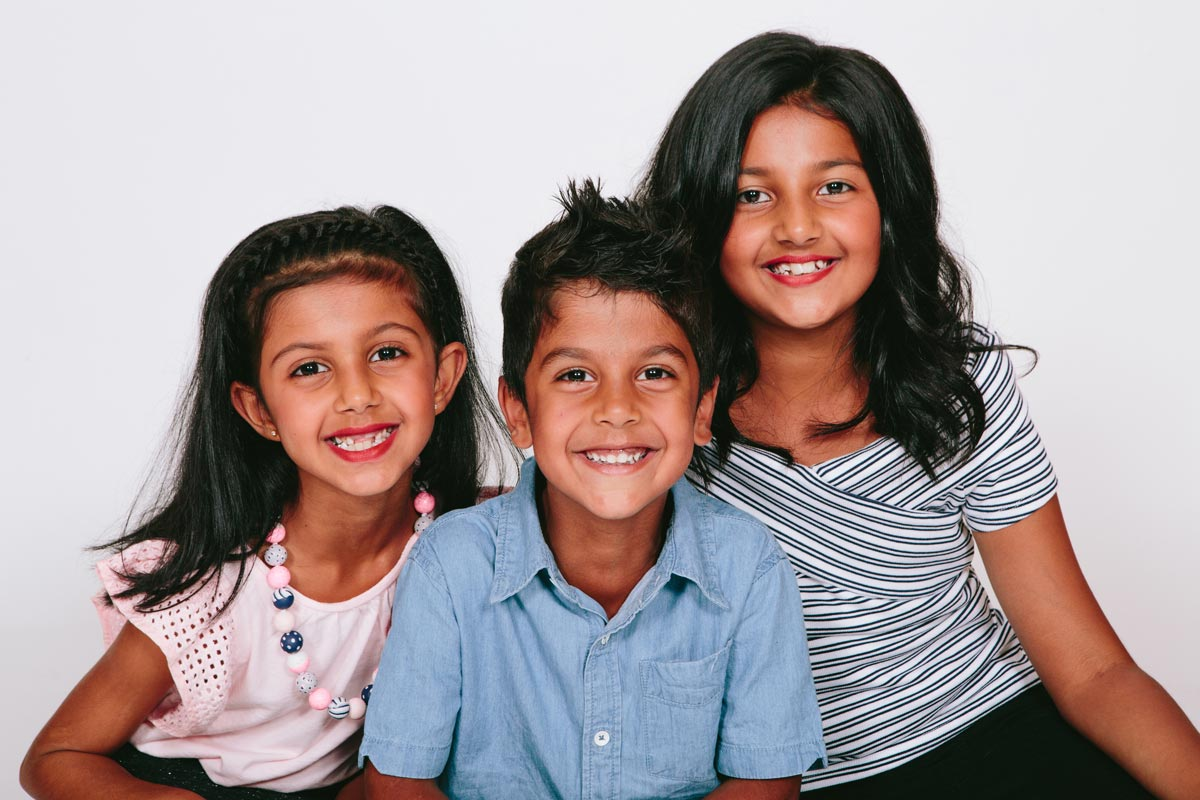 portrait studio photography of sibling children during family photoshoot in west harbour auckland by sarah weber photography