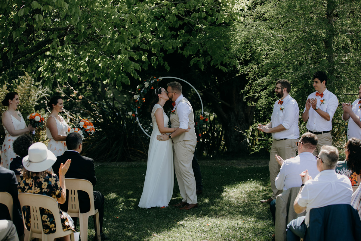 Coatesville settlers hall auckland wedding ceremony bride and groom kiss by sarah weber photography