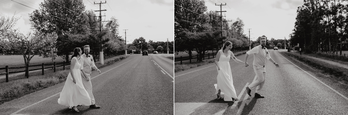Auckland bride and groom running across country road from coatesville settlers hall wedding ceremony