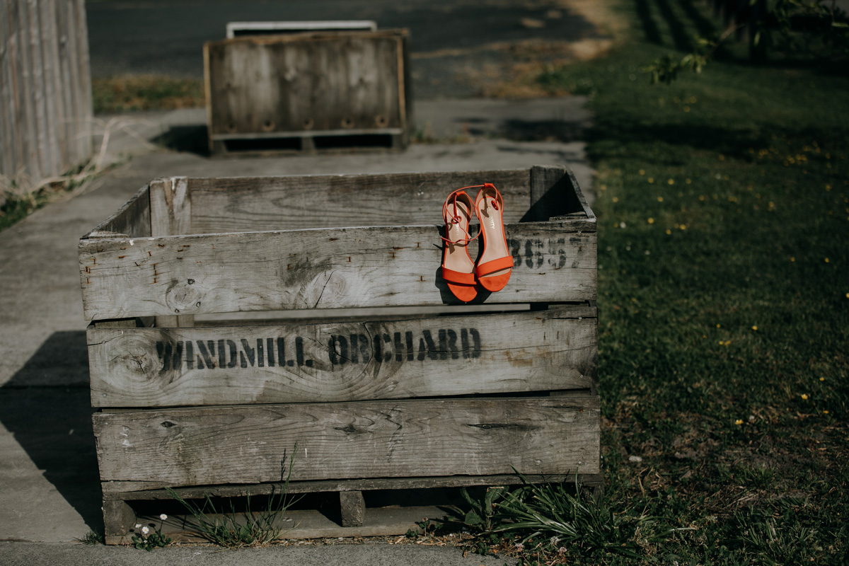 Auckland bride orange wedding shoes in Windmill Orchards from coatesville settlers hall