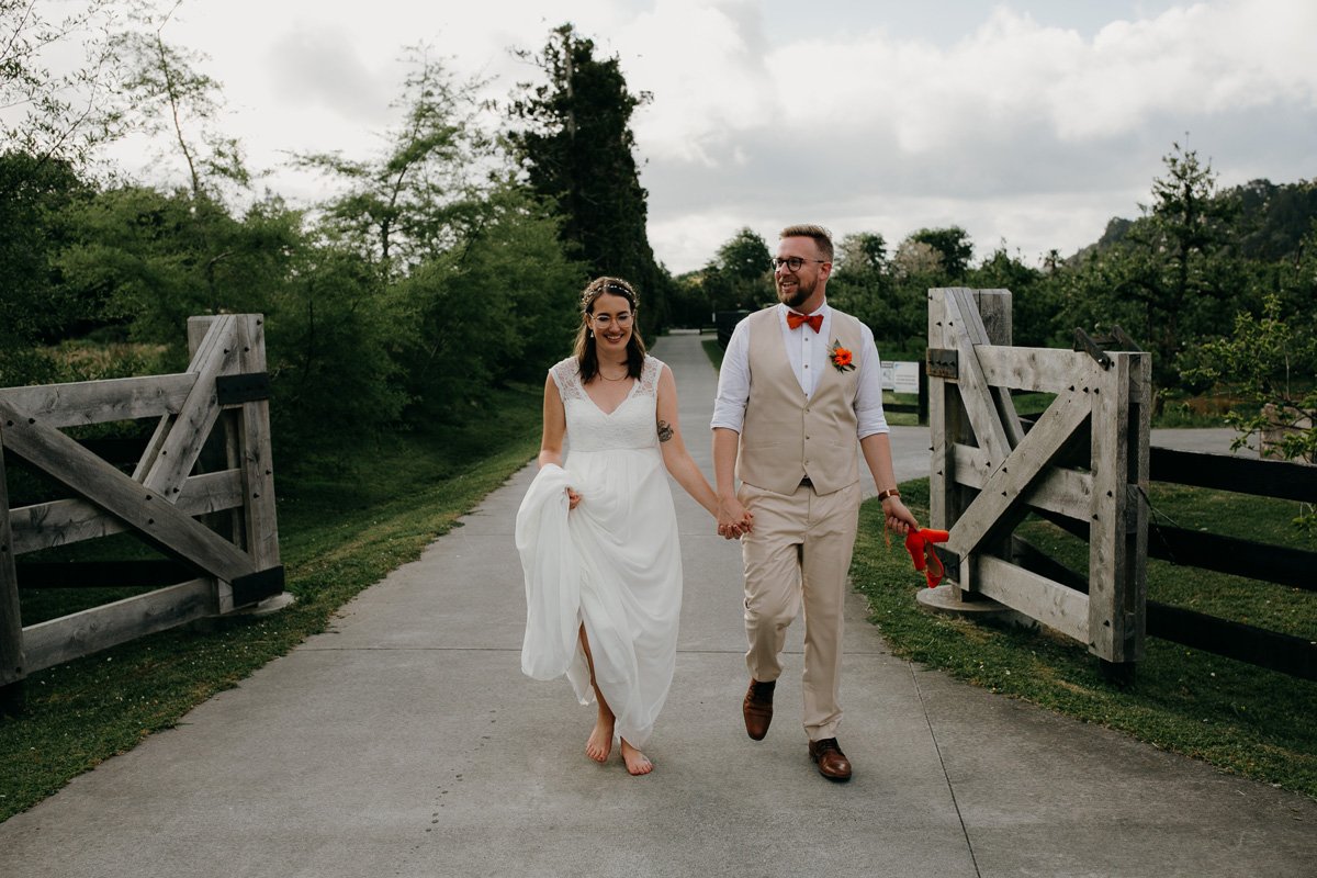 coatesville settlers hall wedding auckland bride and groom leaving Windmill Orchards by sarah weber photography