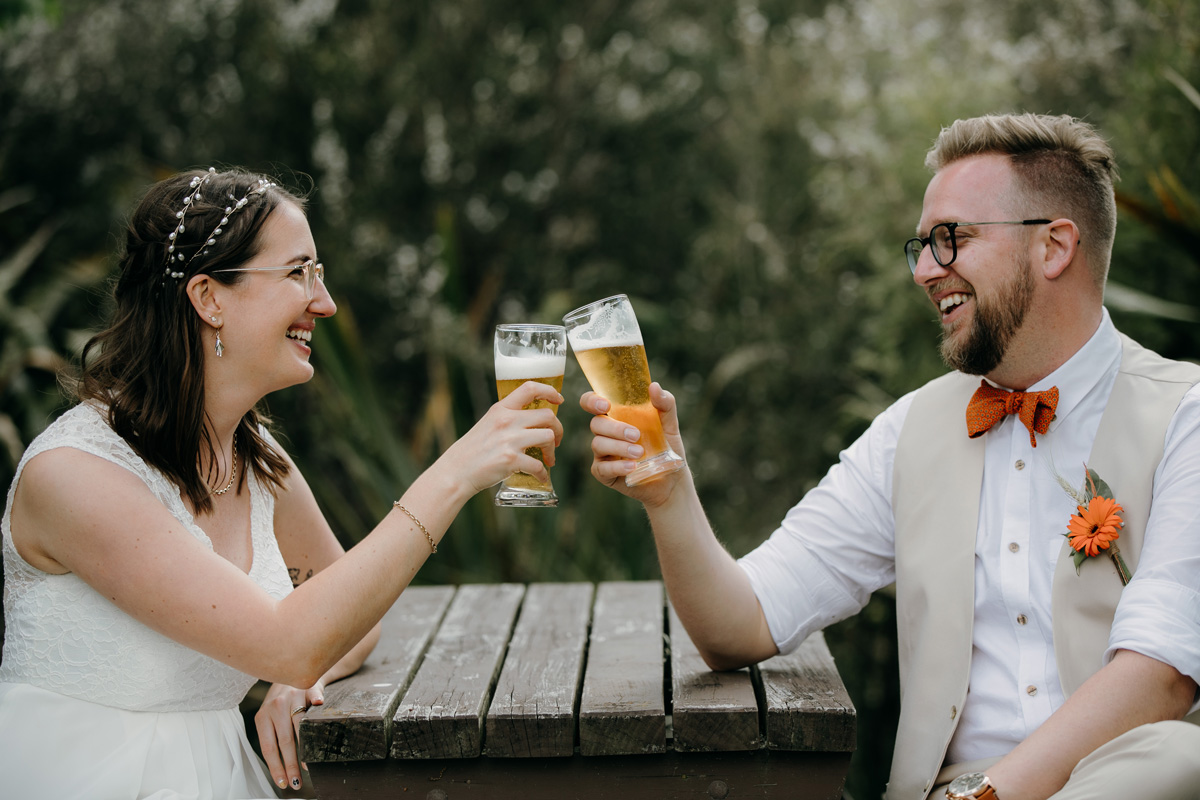 coatesville settlers hall wedding auckland bride and groom beer cheers photos by sarah weber photography