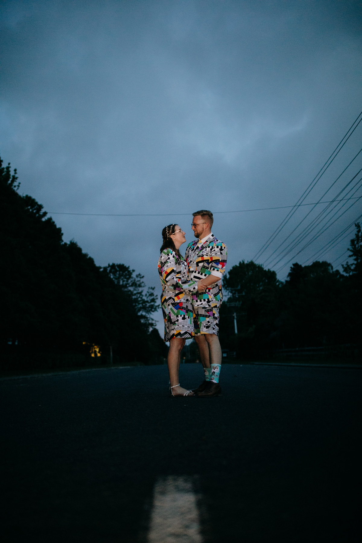 coatesville settlers hall wedding auckland bride and groom in oppo suits night photos by sarah weber photography