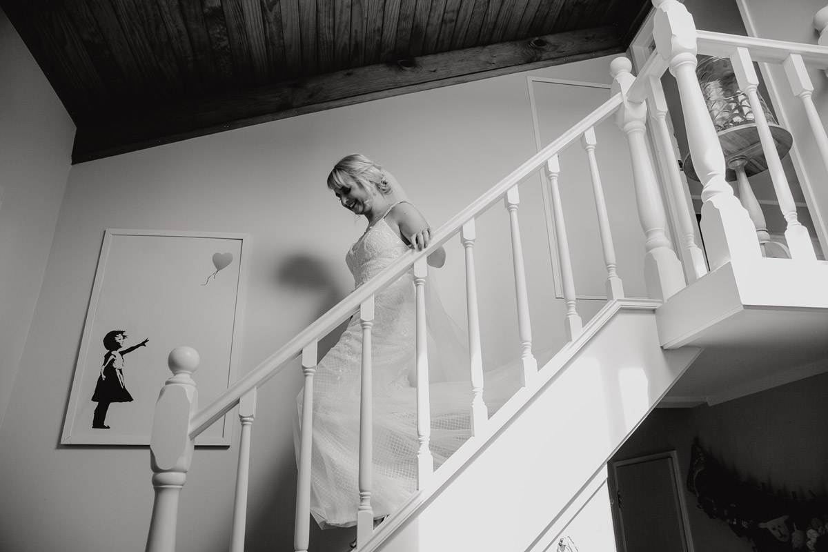 Bride walking down stairs to father Auckland wedding photo by Sarah Weber Photography