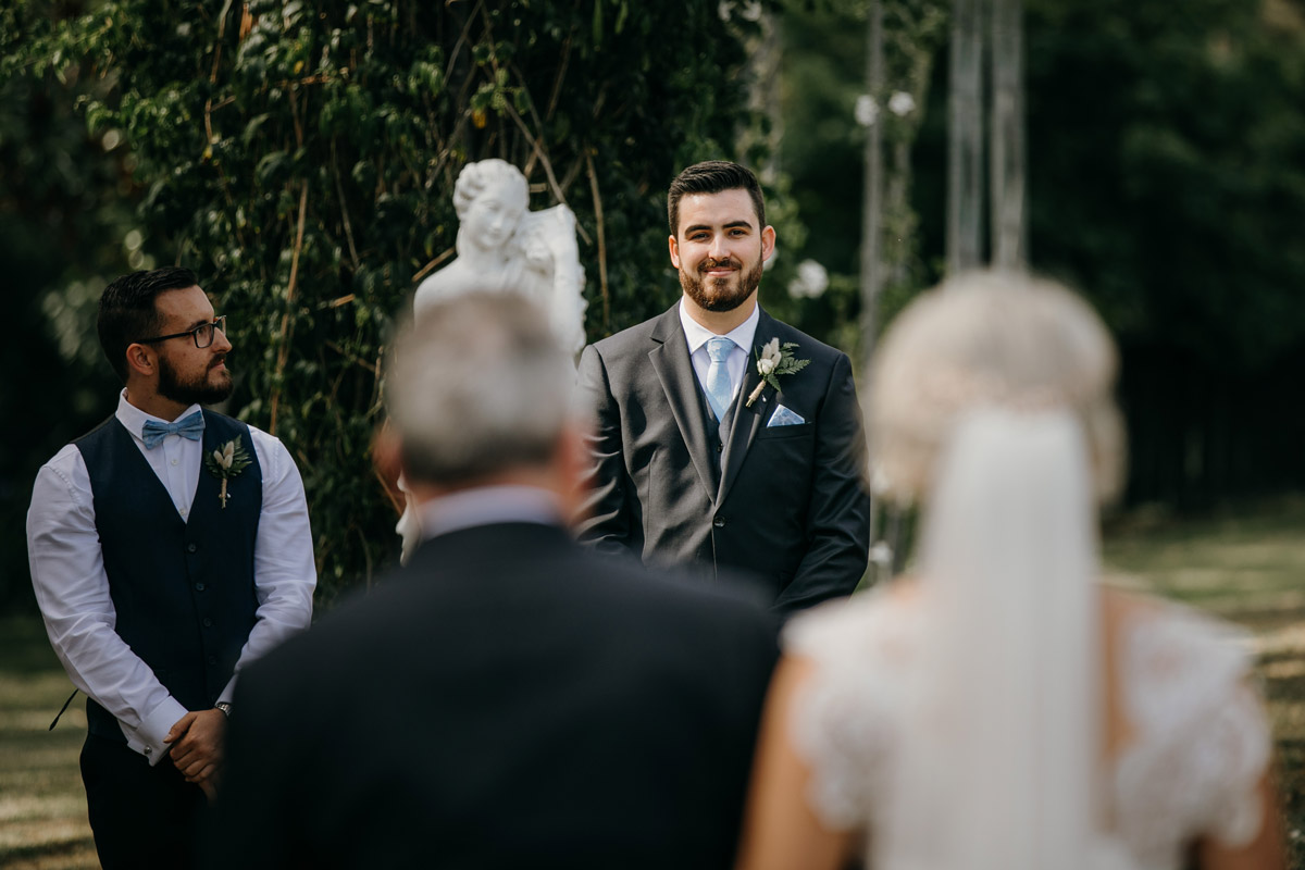 Grooms first look at Bride Wedding ceremony at The Brigham Restaurant & Cafe in Whenuapai, Auckland photo by Sarah Weber Photography