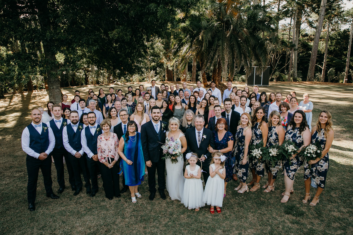 Wedding guests group photo at The Brigham Restaurant & Cafe in Whenuapai, Auckland photo by Sarah Weber Photography