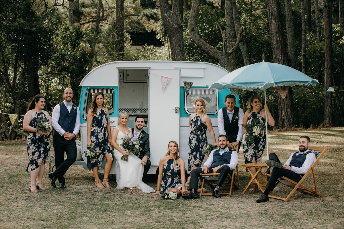 Bridal party posing infront of Caravan at The Brigham Restaurant & Cafe in Whenuapai, Auckland photo by Sarah Weber Photography