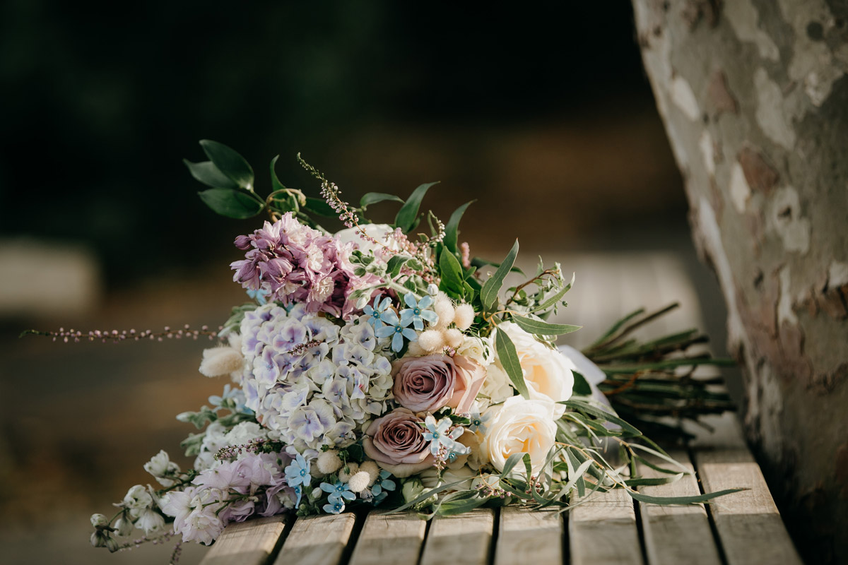 Bride's flowers at Herald Island Wharf in Whenuapai, Auckland photo by Sarah Weber Photography