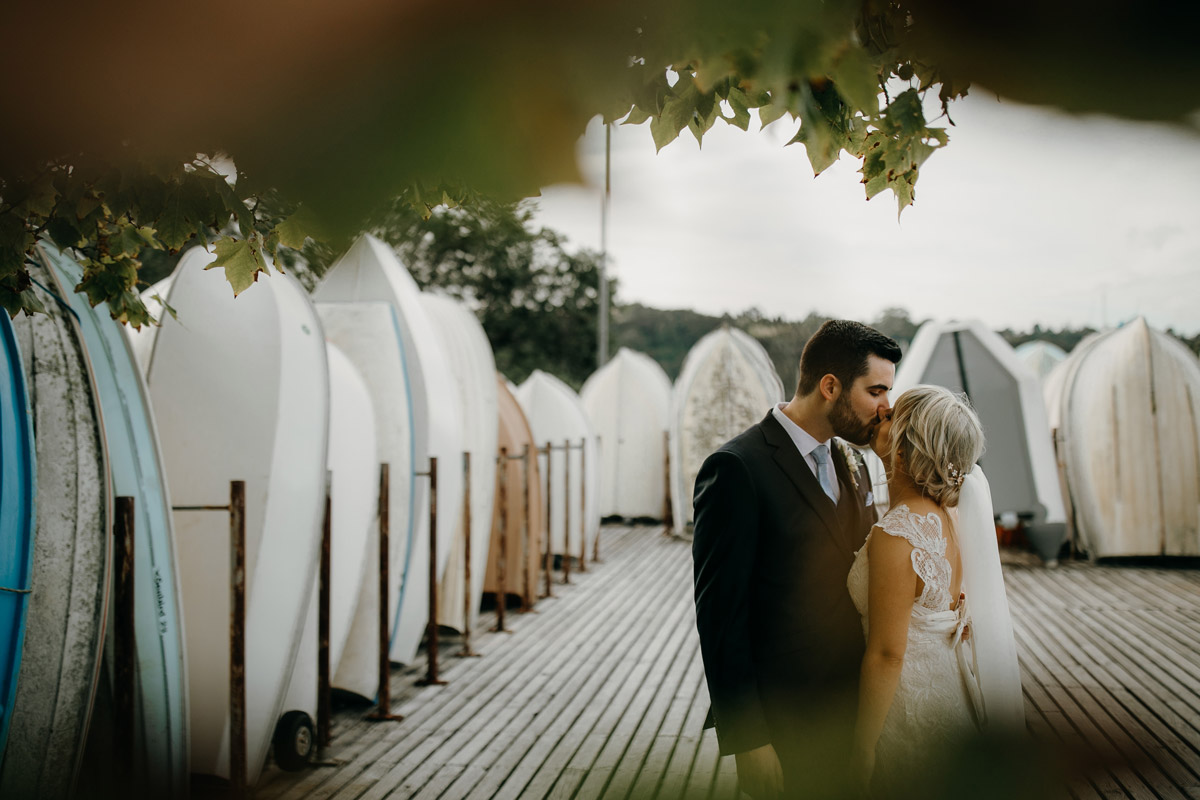 Bride and Groom kissing at Herald Island Wharf in Whenuapai, Auckland photo by Sarah Weber Photography