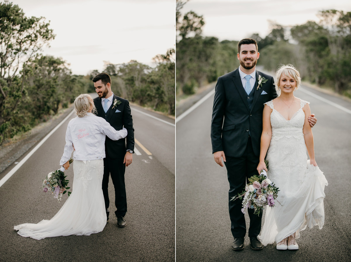 Bride and Groom posing on Herald Island Road in Whenuapai, Auckland photo by Sarah Weber Photography