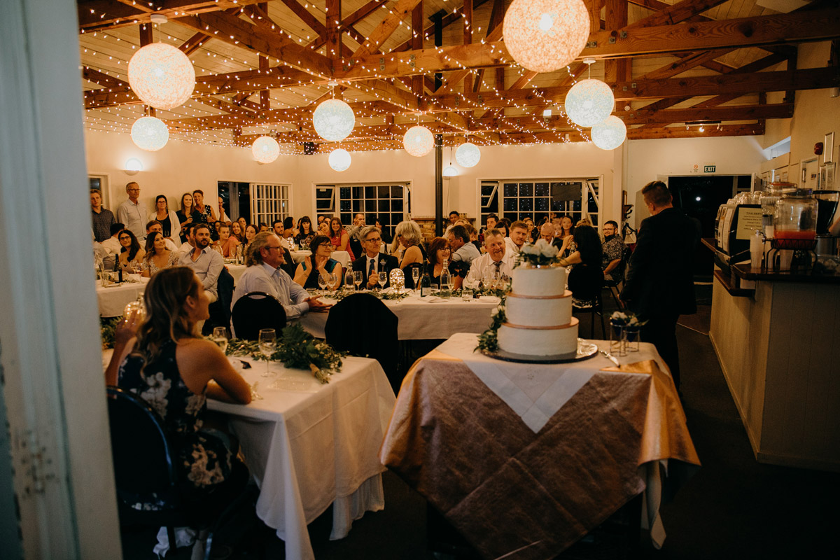 Guests seated and speeches at The Brigham wedding reception venue photo by Sarah Weber Photography