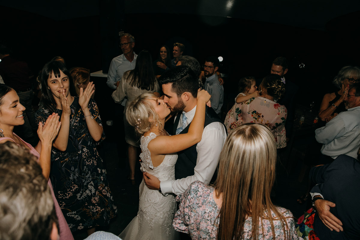 Bride and Groom first dance kiss photo by Sarah Weber Photography