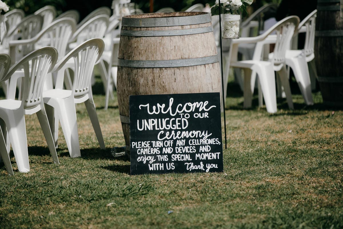 unplugged garden wedding ceremony sign at bridgewater country estate venue in Kaukapakapa, Auckland photo by sarah weber photography