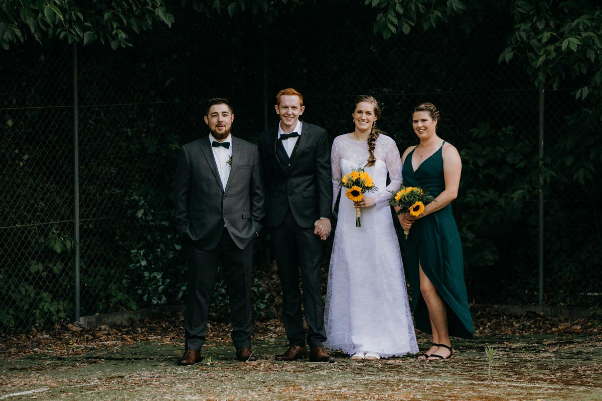 bridal party creative photos on old tennis court at bridgewater country estate venue in Kaukapakapa, Auckland photo by sarah weber photography