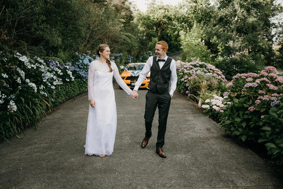 bride and groom photos with mustang car at bridgewater country estate venue in Kaukapakapa, Auckland photo by sarah weber photography
