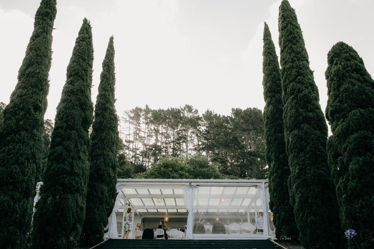 outside wedding reception at bridgewater country estate venue in Kaukapakapa, Auckland photo by sarah weber photography