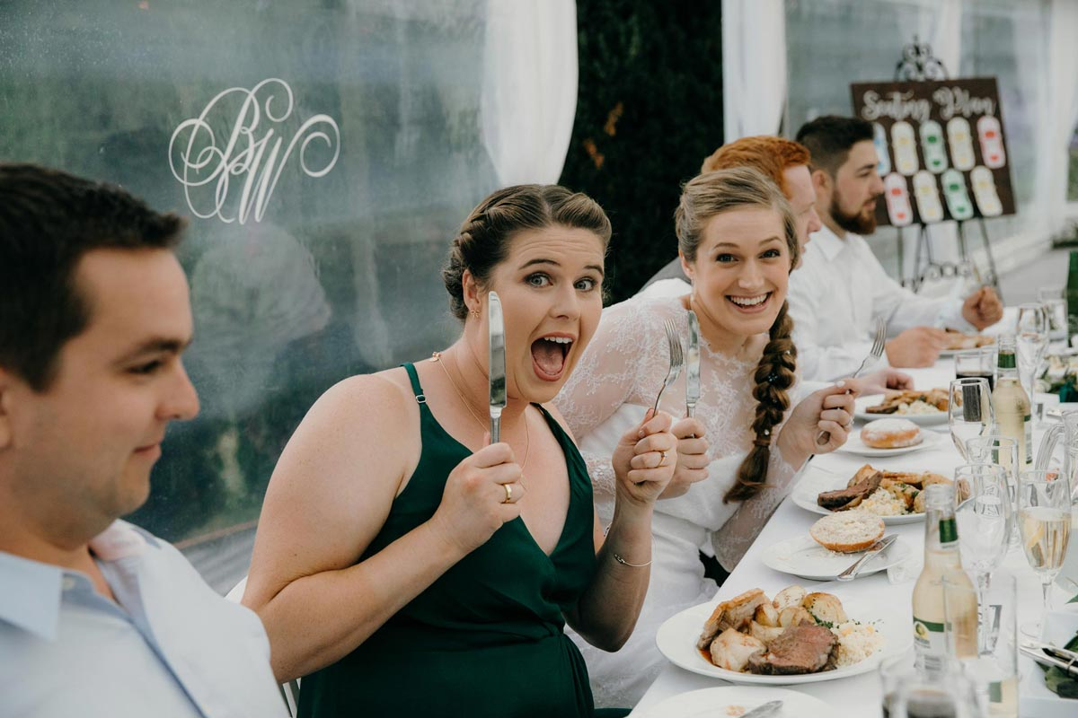 bridesmaid bring silly during wedding reception at bridgewater country estate venue in Kaukapakapa, Auckland photo by sarah weber photography