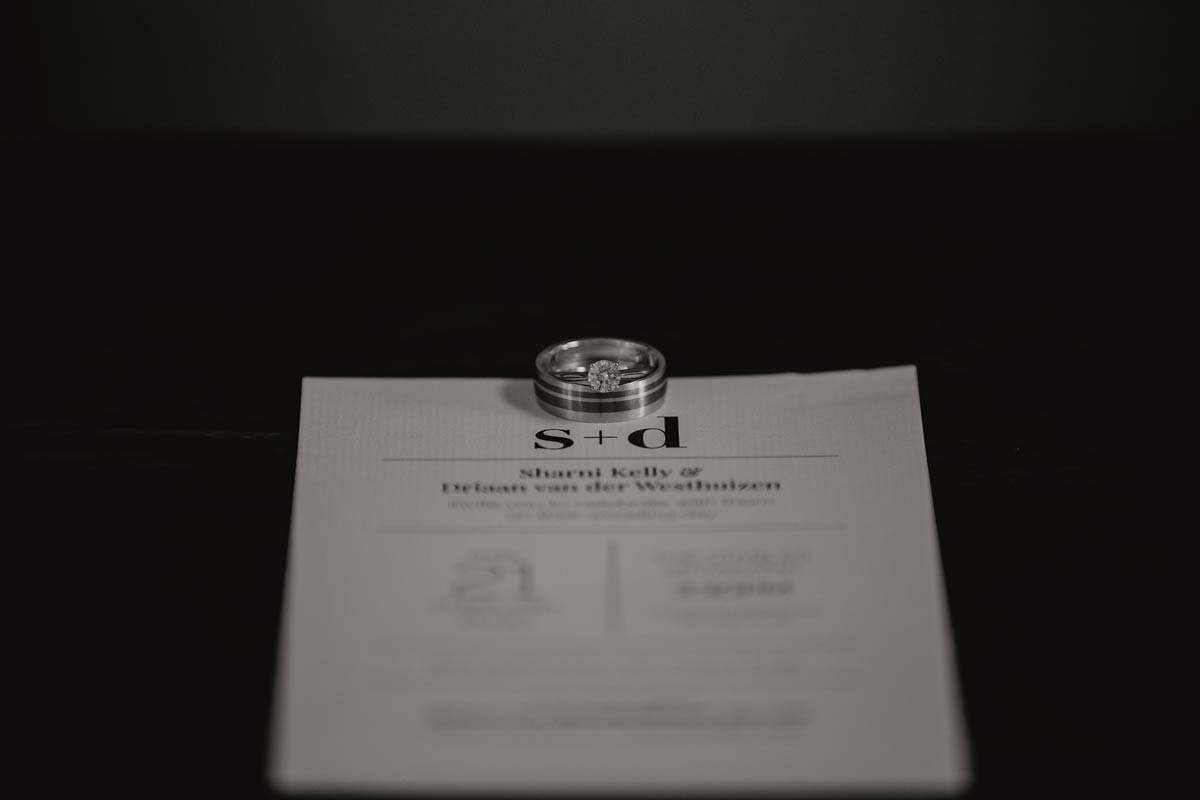 wedding invitation with bride and groom wedding rings photo by sarah weber photography