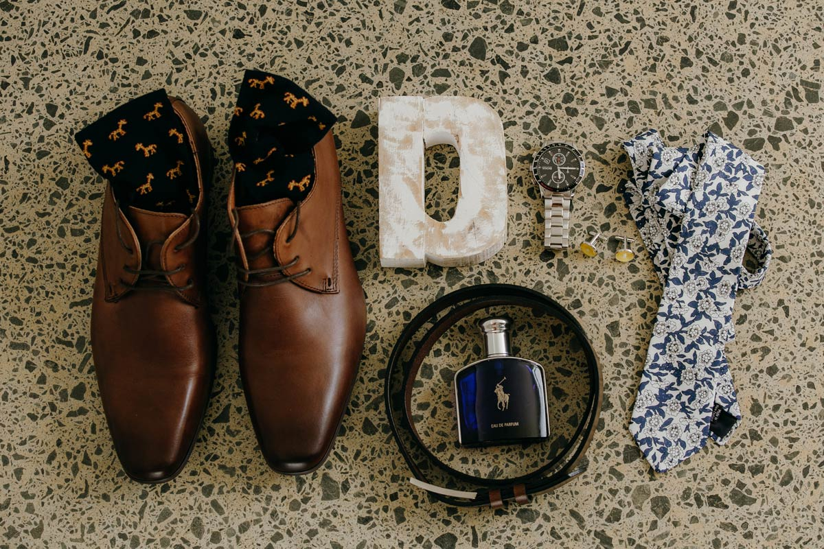 groom wedding details of shoes tie socks watch at omaha beach before stables matakana wedding by sarah weber photography