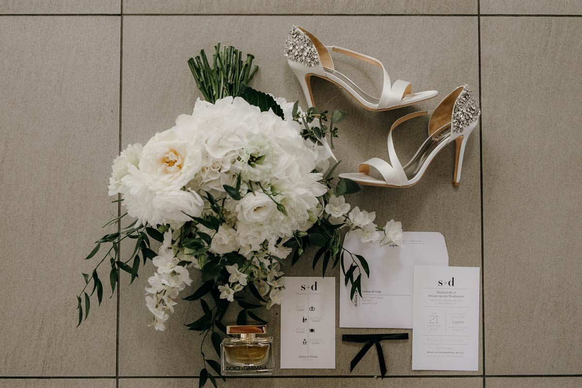 bride details of flowers, shoes, purfume, stationery at the dunes, omaha lodge before the stables matakana wedding photos by sarah weber photography