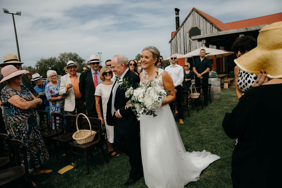 bride and father of the bride at the the stables matakana country park wedding venue near omaha beach photos by sarah weber photography