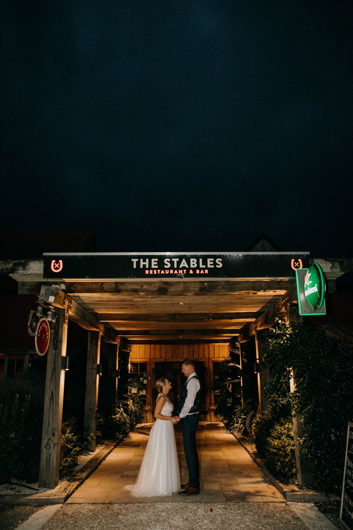 bride and groom night creative evening photos outside the stables matakana wedding venue by sarah weber photography